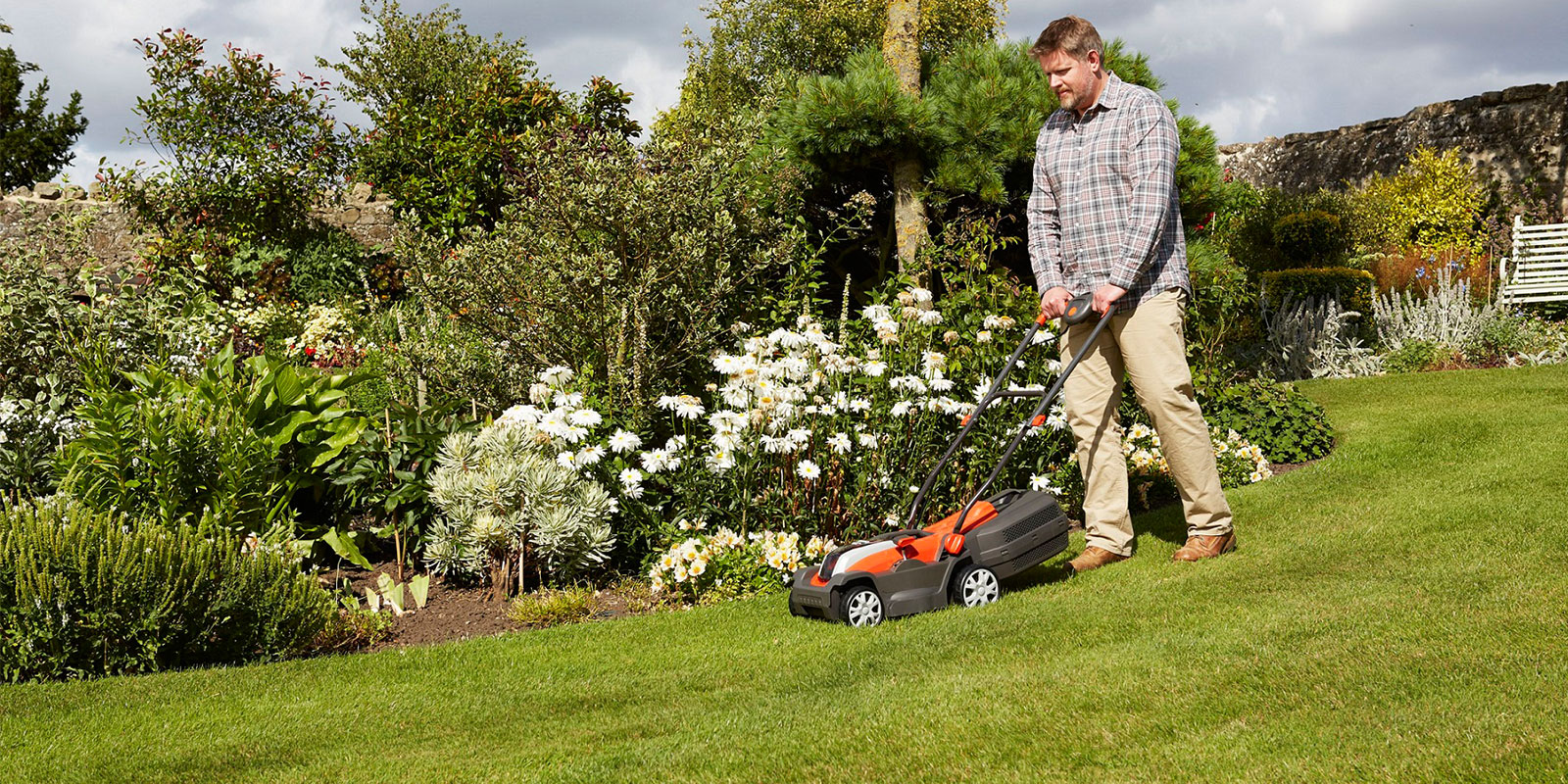 Flymo man mowing lawn