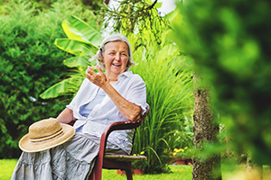 Woman Living With Dementia enjoying the Benefits of Gardening