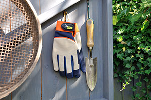 Treadstone Clever Clip Gloves hanging on a wall