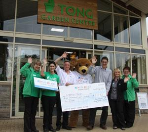 Martin House and Tong Garden Centre staff celebrating the donation